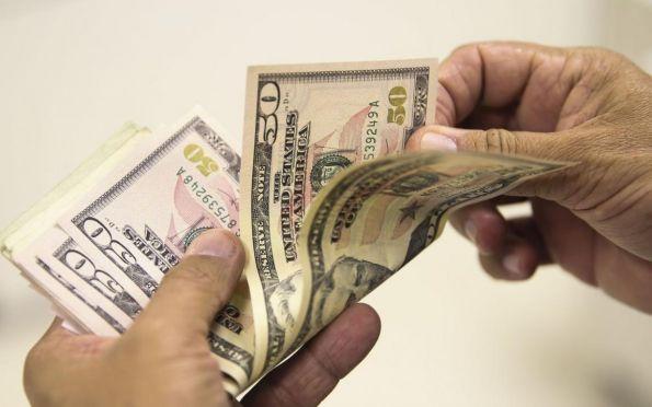 Dólar cai para R$ 5,50 após intervenção do Banco Central